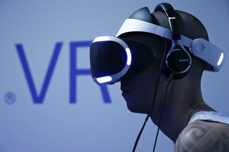 A visitor plays a game on a PlayStation VR at the Paris Games Week, a trade fair for video games in Paris
