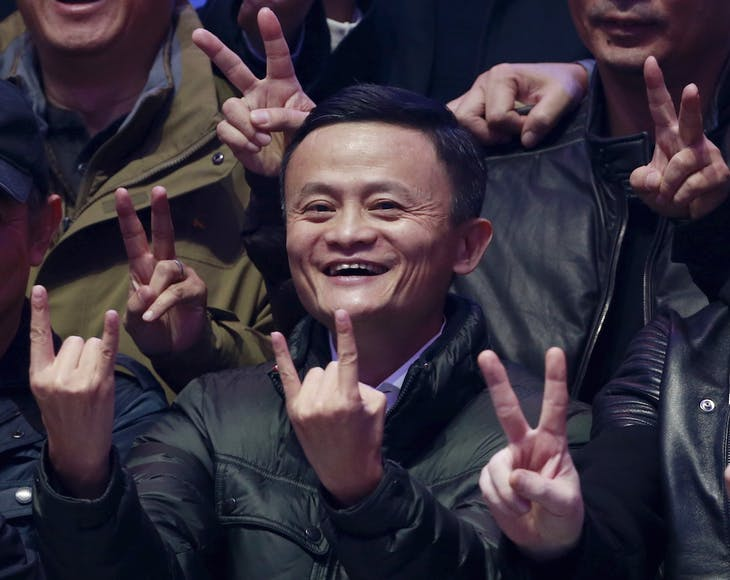 Alibaba founder and chairman Jack Ma smiles as he poses with attendants after watching real-time data of transactions at Alibaba Group's 11.11 Global shopping festival in Beijing, China, November 11, 2015. REUTERS/Kim Kyung-Hoon      TPX IMAGES OF THE DAY      - RTS6CC7