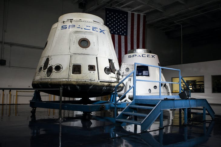 SpaceX spacecrafts the Dragon and the DragonRider sit on display at the SpaceX facility in Hawthorne