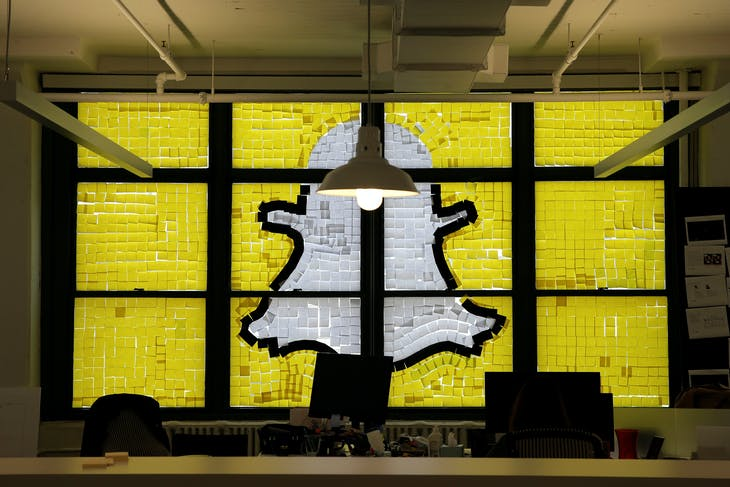 "An image of the Snapchat logo created with Post-it notes is seen in the windows of Havas Worldwide at 200 Hudson Street in lower Manhattan, New York, U.S., May 18, 2016, where advertising agencies and other companies have started what is being called a ""Post-it note war"" with employees creating colorful images in their windows with Post-it notes. REUTERS/Mike Segar - RTSEXH6"