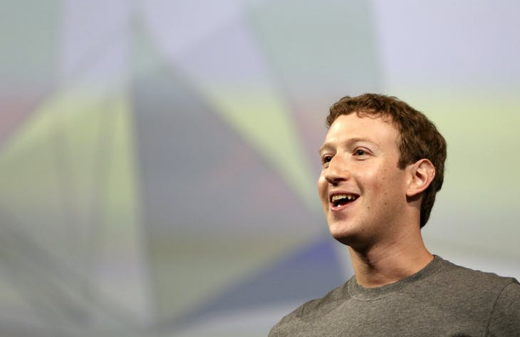 Facebook CEO Mark Zuckerberg addresses the crowd gathered during his keynote address at Facebook's f8 developers conference in San Francisco, California April 30, 2014. REUTERS/Robert Galbraith  (UNITED STATES - Tags: BUSINESS) - GM1EA51070P01
