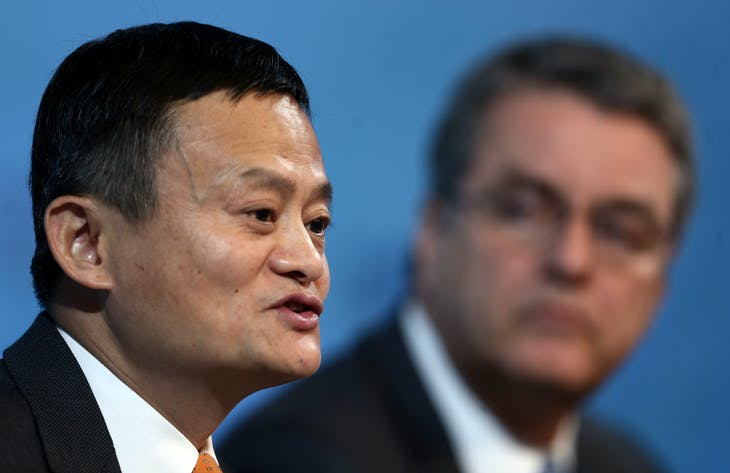 Alibaba Group Executive Chairman Jack Ma speaks next to Director-General of the World Trade Organization Roberto Azevedo talk at the 11th WTO's ministerial conference in Buenos Aires, Argentina December 11, 2017. REUTERS/Marcos Brindicci - RC15C1A8BDE0